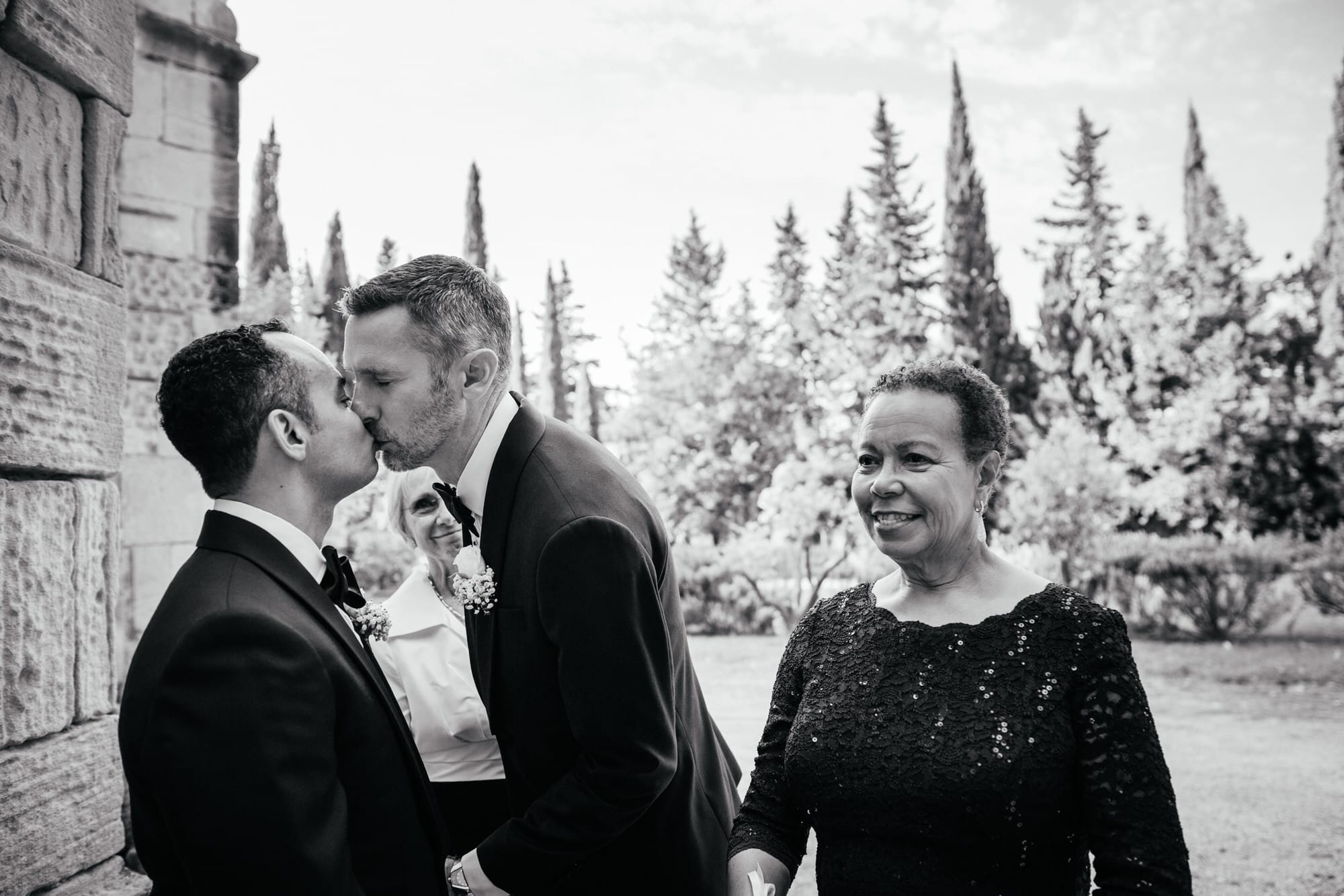 Gay Couple kisses while waiting to go to the ceremony on their wedding day