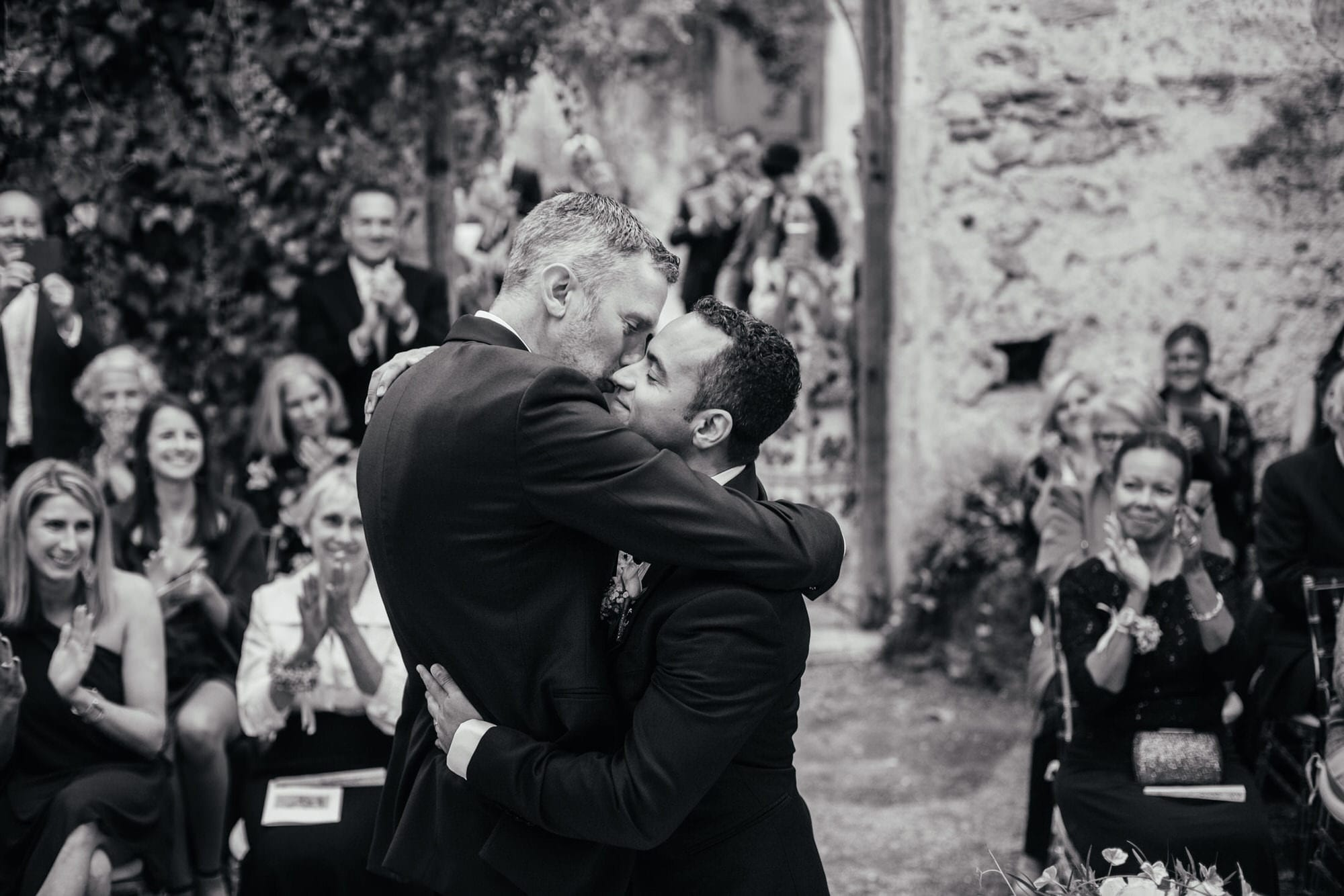 two grooms hug with passion after exchanging rings their rings at their wedding in Lisbon