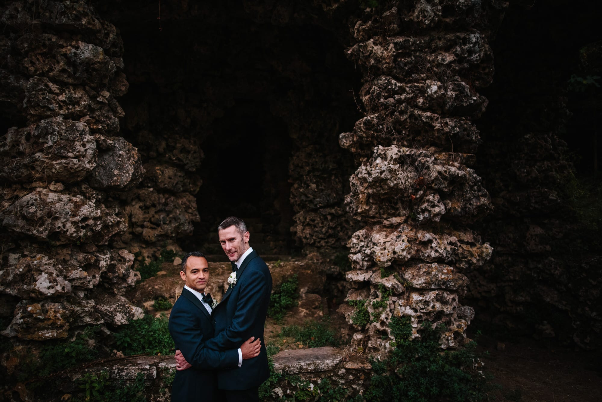 Two grooms pose for their portraits on their wedding day