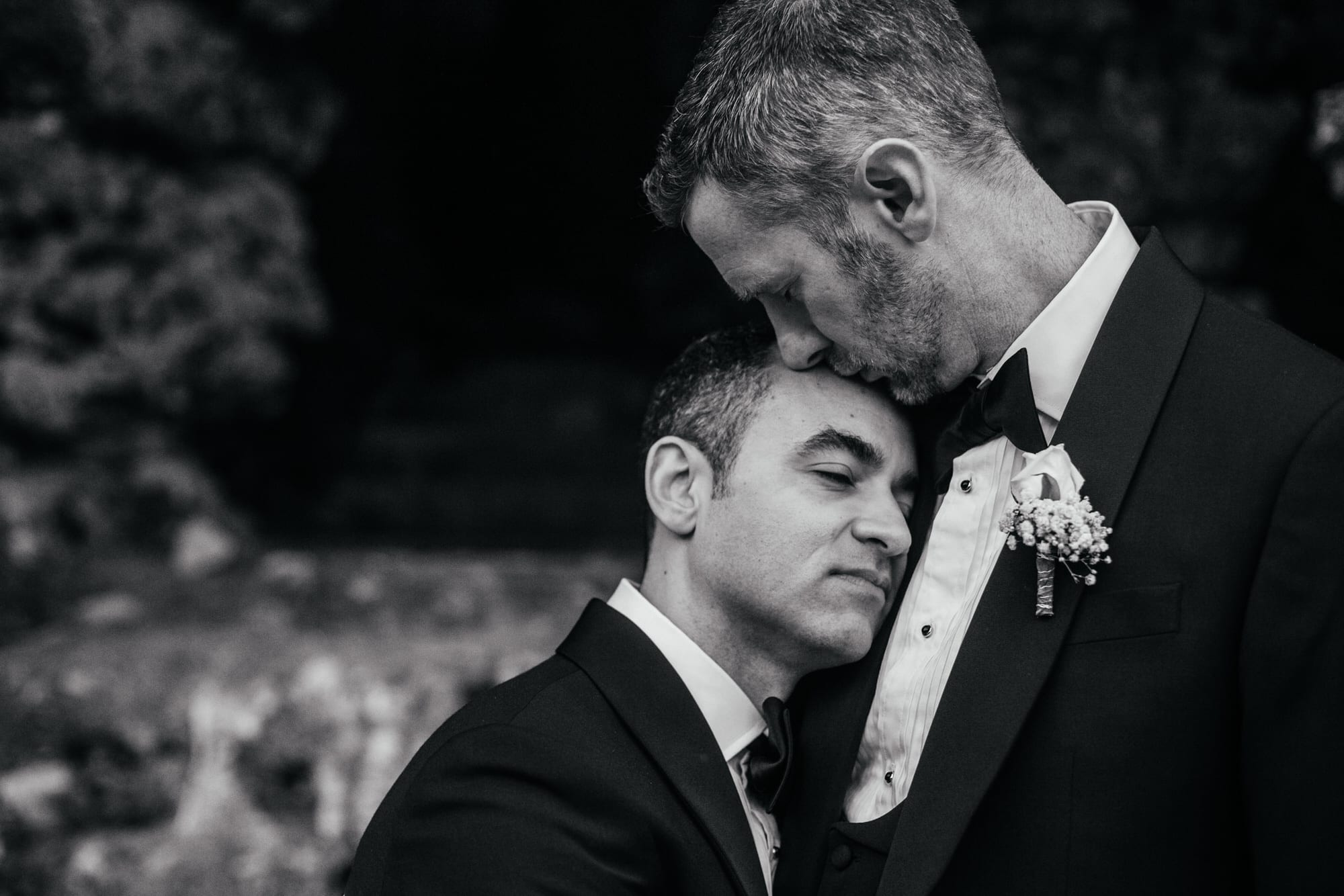Gay couple posing for an intimate portrait on their wedding day in Lisbon